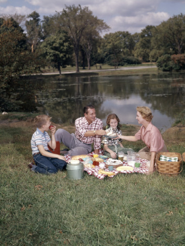 H-armstrong-roberts-retro-family-sitting-together-enjoying-picnic-food